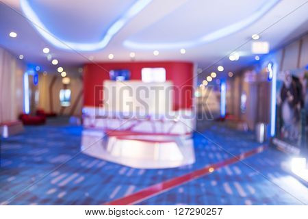 Cinema interior. Blur of Defocus Background of People Waiting Areas in Movie or Cinema Complex Lounge