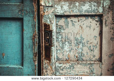 The texture of old door which the old paint flaking. The texture of old door which the old paint flaking