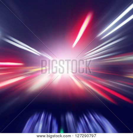 Blurred motion image of car driving fast at night.