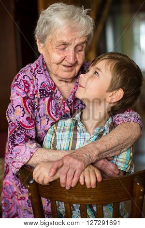 Grandmother hugging her little grandson.
