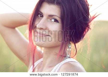 Beautiful girl posing in the summer on a meadow smiling happily enjoying leisure, fashion style, natural beauty, sunny summer day.
