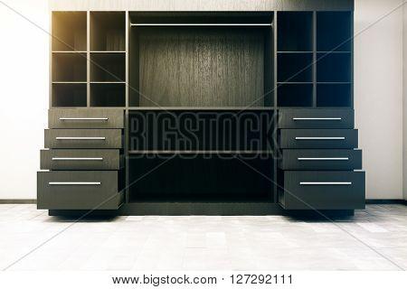 Frontview of dark wooden cupboard in concrete interior. 3D Rendering