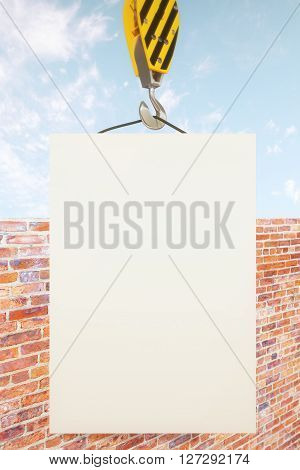 Blank poster on crane hook with clear sky and brick wall in the background. Mock up 3D Rendering