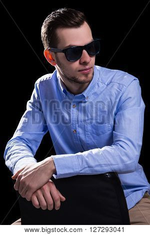 Young Handsome Man In Sunglasses Over Black