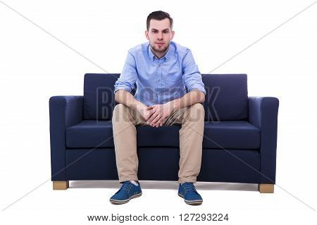Young Handsome Man Sitting On Sofa Isolated On White