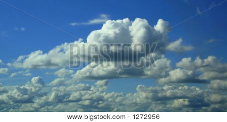 Clouds Over The Blue Sky
