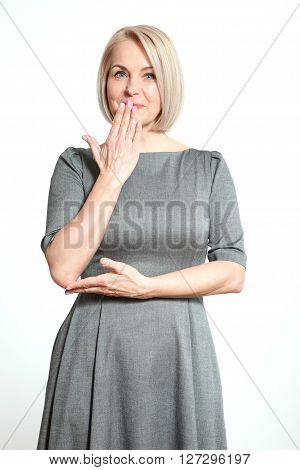 Portrait  beautiful woman with finger on lips, or secret gesture hand sign  isolated on white background