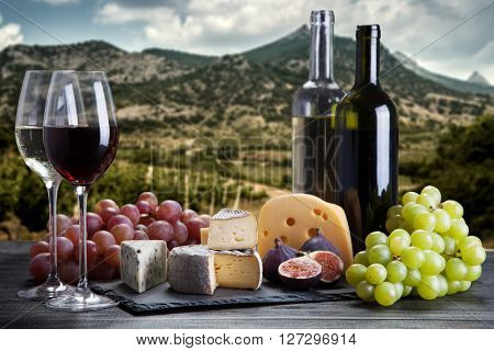 Wine, grapes and cheese assortment