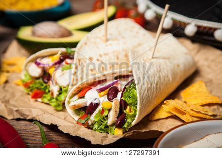Traditional mexican tortilla wrap with a mix of ingredients