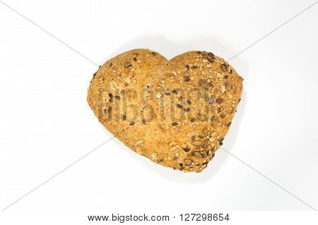 Love for wholemeal bread with seeds of sesame mustard and sunflower on white background