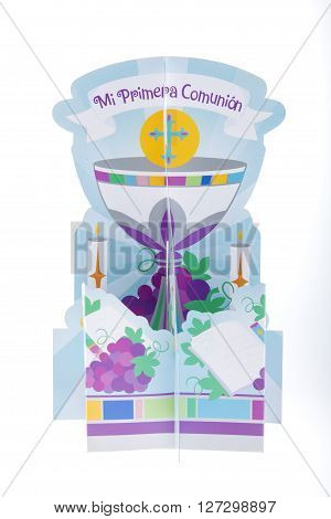 A first communion centerpiece against a white background