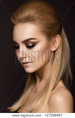 Beautiful woman with evening make-up long straight hair . Smoky eyes. Fashion photo. Portrait shot in studio