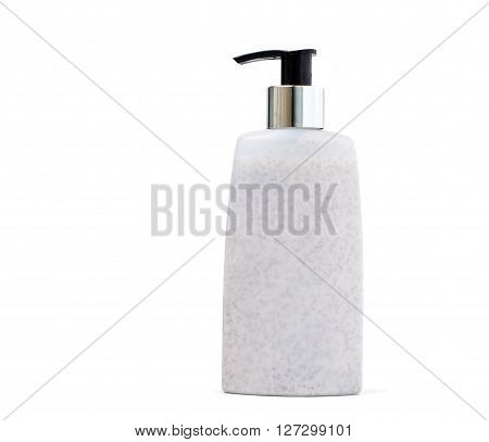 Skin exfoliation cream in a pump plastic bottle isolated on white.