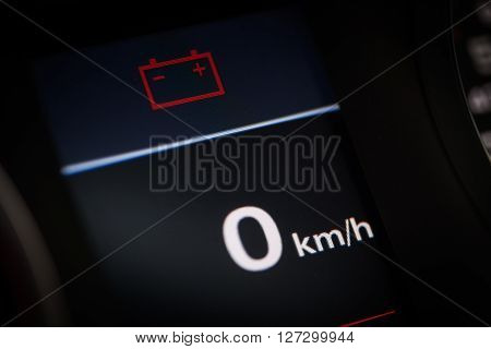 Color detail of the battery warning symbol in a car.