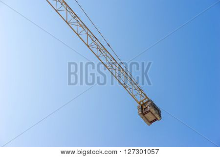 the yellow Crane working and Blue Sky