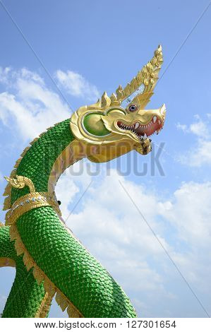 close up King of Naga statue on blue sky