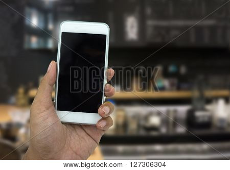 Hand Holding Smart Phone Over Blur Background