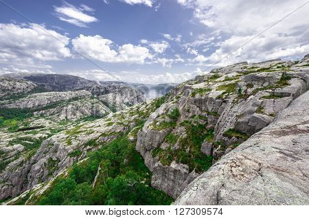 Trekking in Norwegian fjords - view over Lysefjord from a trail to Preikestolen aka the Pulpet Rock (Lysefjord)