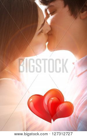 Young romantic couple kissing in love with sun light