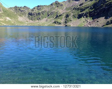 A blue lake in the pyrenees mountains