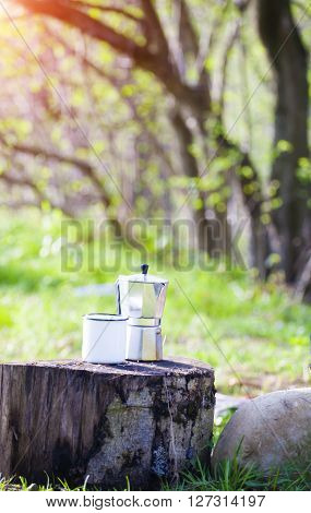 Coffee And Mug Are Camping Outdoors.