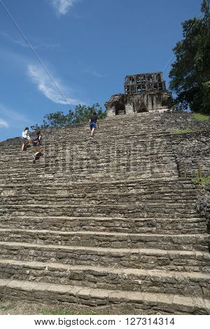 Tourists Climb Stairs At Palenque Site In Mexico
