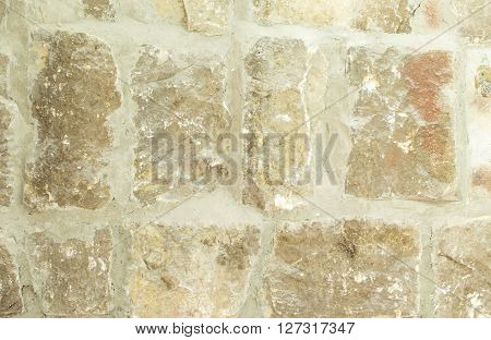 Old moldy stone wall with concrete. Photo can be used as a whole background.