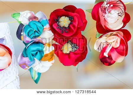 Beautiful textile brooches from artificial flowers. Macro shot.