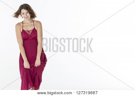 A female model posing in a studio environment