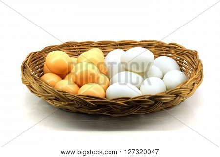 Duck Eggs And Brown Eggs In The Basket Isolated On White Background