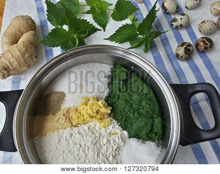 Cooking nettles ginger cake organic food with wild plants and quail eggs