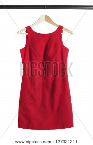 Red cocktail dress on clothes rack isolated over white