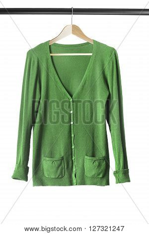 Green cashmere cardigan on clothes rack isolated over white