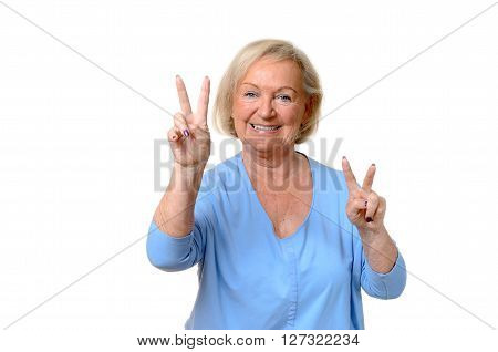 Smiling Elderly Woman Giving A Double V-sign
