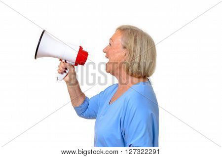 Profile Of A Senior Woman Using A Megaphone