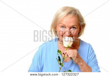 Elderly Woman Smelling A Fresh Pink Rose