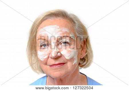 Elderly Lady With Cosmetic Cream On Her Face