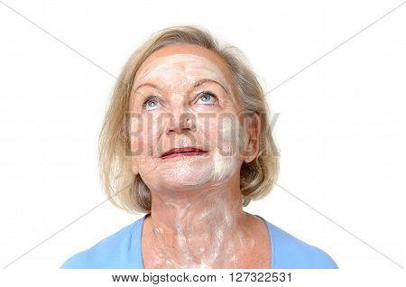Smiling Elderly Lady With Face Cream On Her Skin