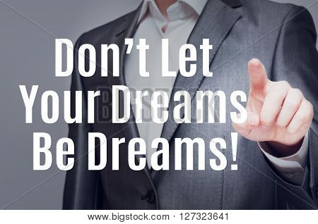 Don't Let Your Dreams Be Dreams. Man Touching Text On Virtual Screen