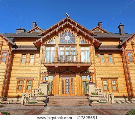 KYIV, UKRAINE - SEPTEMBER 14, 2014: Mezhyhirya - former private residence of ex-president Yanukovich now open to the public, Kyiv region, Ukraine. Wooden Honka club house
