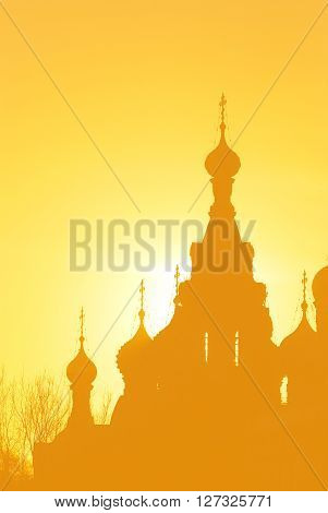 Church of the Savior on Blood in Sait Petersburg at sunset. Yellow and orange silhouette.
