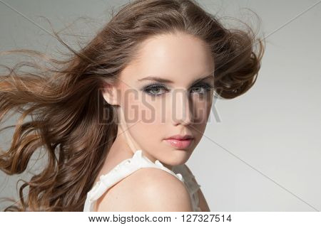 Beautiful girl with long wavy hair . with curly hairstyle