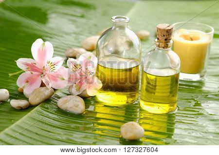 Spa set on banana leaf with two orchid