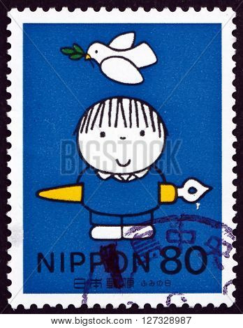 JAPAN - CIRCA 1998: a stamp printed in the Japan shows Child with Ink Pen Dove Overhead Letter Writing Day circa 1998