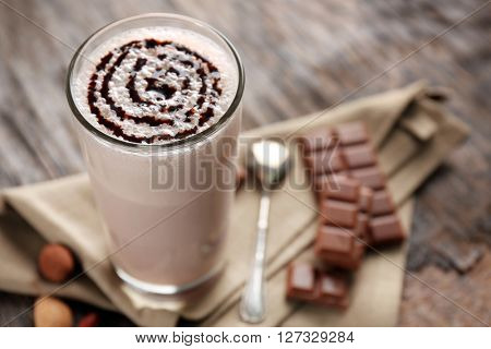 Delicious milk cocktail on rustic background, close up