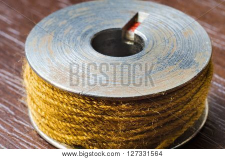 a yellow thread bobbin macro close up