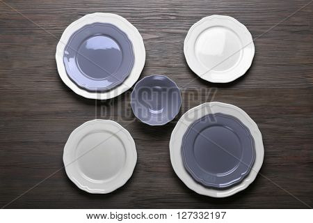 Empty dishes on  wooden background.