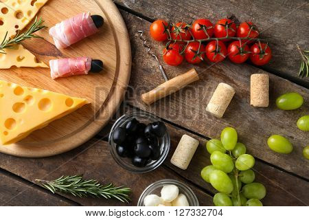 Different various of cheese and snacks, flat lay