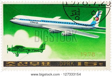 MOSCOW RUSSIA - APRIL 10 2016: A stamp printed in DPRK (North Korea) shows American passenger aircraft Douglas DC-8-63 and old airplane series