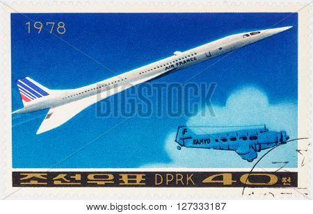 MOSCOW RUSSIA - APRIL 09 2016: A stamp printed in DPRK (North Korea) shows Anglo-French supersonic passenger aircraft Concorde and old airplane series